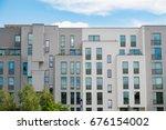 modern apartment building... | Shutterstock . vector #676154002