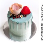 Small photo of Fruit cake with chocolate velour heart and flower