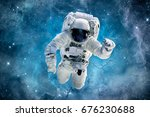 astronaut in magic blue galaxy. ...