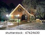 Christmas decorated cottage - stock photo