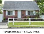 suburban home brick bungalow...   Shutterstock . vector #676277956