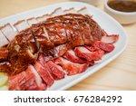 roast duck and roast pork  thai ... | Shutterstock . vector #676284292