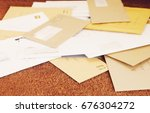 closeup of a pile of mail on... | Shutterstock . vector #676304272