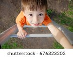 boy climbing stairs and playing ... | Shutterstock . vector #676323202