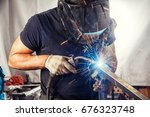 A Strong Man Is A Welder In A...