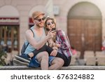 happy young couple using a... | Shutterstock . vector #676324882