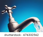water pouring from tap close up | Shutterstock . vector #676332562