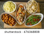 bowls of meal side dishes of... | Shutterstock . vector #676368808