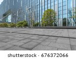 empty pavement and modern... | Shutterstock . vector #676372066