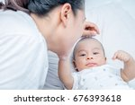 mother and adorable baby boy... | Shutterstock . vector #676393618
