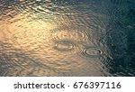 rain drops on the water pool... | Shutterstock . vector #676397116