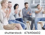 happy people clapping at... | Shutterstock . vector #676406602