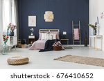 painting hanging on dark blue... | Shutterstock . vector #676410652