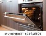 empty open electric oven with... | Shutterstock . vector #676415506