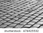 cobblestone road in paris in... | Shutterstock . vector #676425532