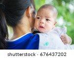 cute newborn asian baby  mother ... | Shutterstock . vector #676437202