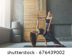 yoga instructor and young woman ... | Shutterstock . vector #676439002