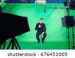 tv presenter preparing to live... | Shutterstock . vector #676451005
