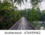 wooden suspension bridge across ... | Shutterstock . vector #676459462