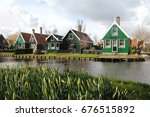 classic green wooden houses at...   Shutterstock . vector #676515892