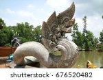 Small photo of Thai king dragon or king of Naga, Statue serpent naga in the pool , Praya Nark or Naga in Thai, Praya Nark name of big snake or serpent dragon