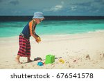 little boy play with sand on... | Shutterstock . vector #676541578