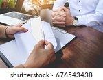 hand of a businessman hands...   Shutterstock . vector #676543438