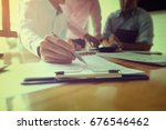business team meeting present... | Shutterstock . vector #676546462