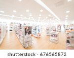 blurred image a beauty stores... | Shutterstock . vector #676565872