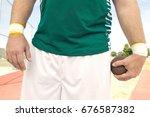 male shot putter holding shot ...   Shutterstock . vector #676587382