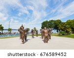Small photo of VANCOUVER, CANADA - JUNE 25: A-maze-ing Laughter bronze sculpture in Morton Park on June 25, 2017 in Vancouver, Canada. It was created as part of an open-air museum for Contemporary Art of Canada.