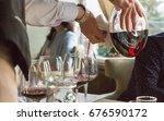 in the restaurant  the waiter... | Shutterstock . vector #676590172