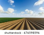 plowed agricultural fields... | Shutterstock . vector #676598596