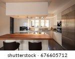 modern kitchen in luxury... | Shutterstock . vector #676605712