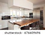 modern kitchen in luxury... | Shutterstock . vector #676609696