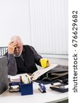 Small photo of Overstressed businessman with burnout in his office