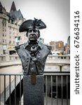 Small photo of OTTAWA - JULY 12, 2017: Bronze bust of Valiants Memorial hero John Butler situated in the Canadian capital for his military and public services during American Revolutionary War and after the war.