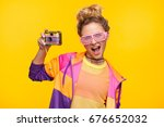 young girl in bright sportive... | Shutterstock . vector #676652032