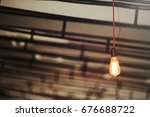 a vintage lamp burns in a warm... | Shutterstock . vector #676688722