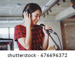 asian beautiful woman singing... | Shutterstock . vector #676696372