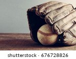 old baseball and glove on wood... | Shutterstock . vector #676728826