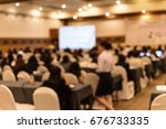 blurred rear view of audience... | Shutterstock . vector #676733335