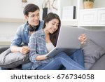 young couple people using... | Shutterstock . vector #676734058