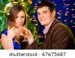 Young happy loving couple celebrating with champagne - stock photo