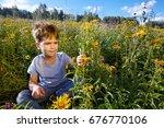 the boy studies the world... | Shutterstock . vector #676770106