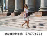beautiful young model with long ... | Shutterstock . vector #676776385
