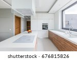 white kitchen with island  long ... | Shutterstock . vector #676815826