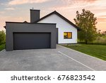 stylish house with garage and... | Shutterstock . vector #676823542