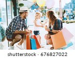 happy family with shopping bags ... | Shutterstock . vector #676827022