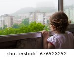 the child looks out the window. ... | Shutterstock . vector #676923292
